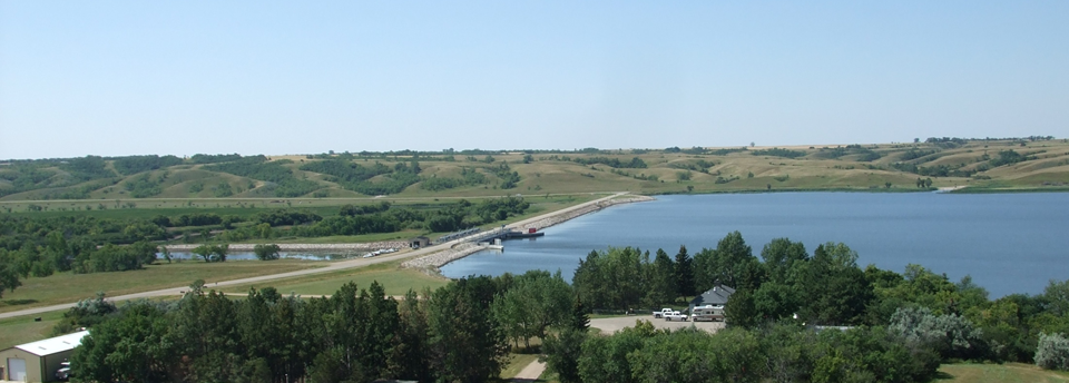 Lake Darling Dam is located approximately 20 mi (32 km) northwest of Minot, North Dakota. It is one of the dams located on the Souris River.