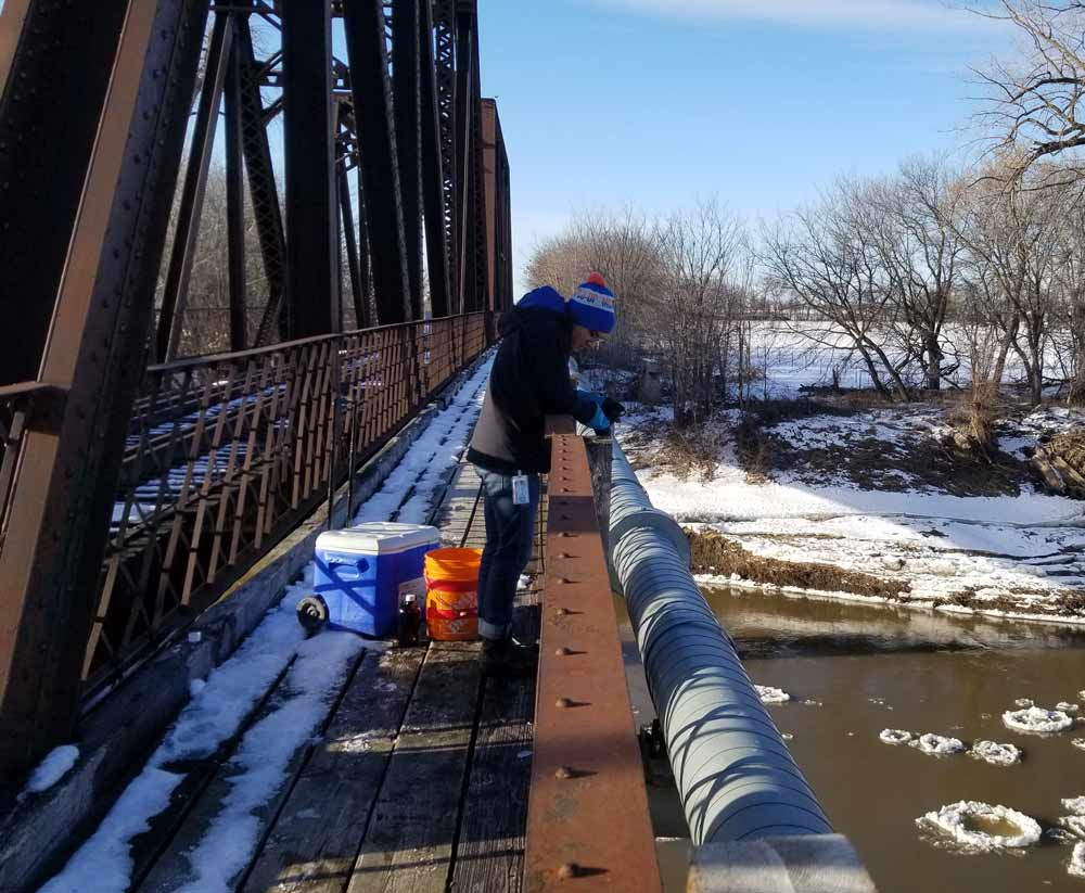 Water monitoring work along the Red River. Credit: Allison Waedt, Environment and Climate Change Canada