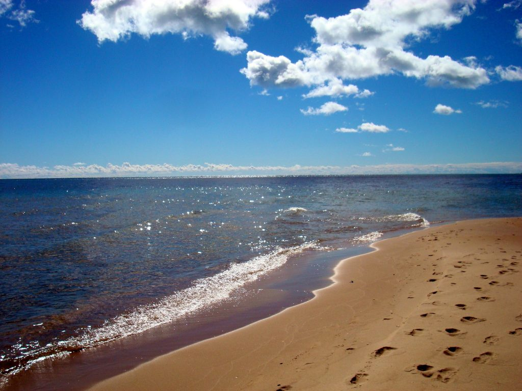 The condition of Great Lakes beaches, like this one on Lake Huron near Oscoda, Michigan, range from good-to-fair, according to a Canada-US report. Credit: BB and HH
