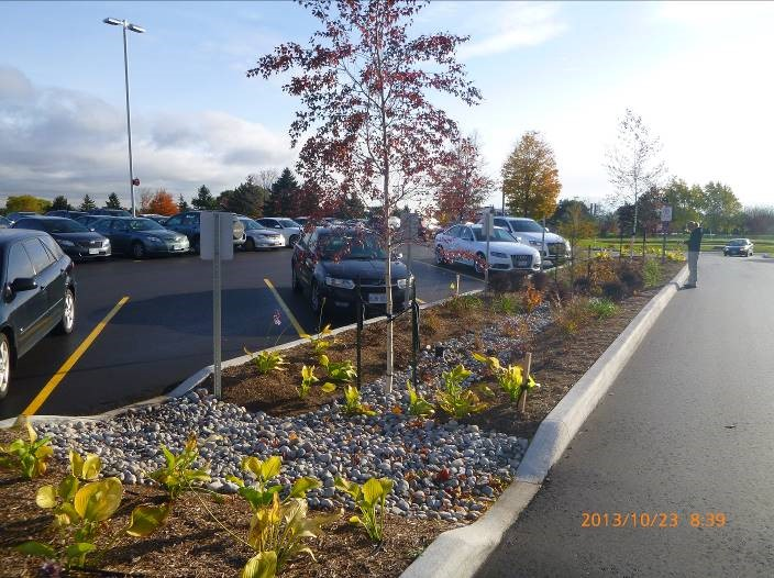 Green infrastructure can provide added safety, reducing parking lot flooding and ice during winter months. Credit: CVC
