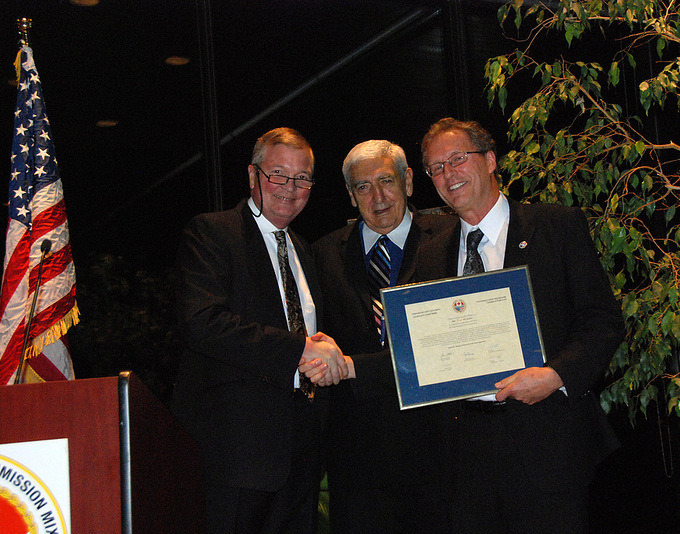 From left to right: Former Commissioner Lyle Knott and Chair Joe Comuzzi pay tribute to retiring IJC engineer Mr. Tom McAuley at the 2012 Fall Semi-Annual Meeting in Ottawa, Ontario. Credit: B. Beckhoff.