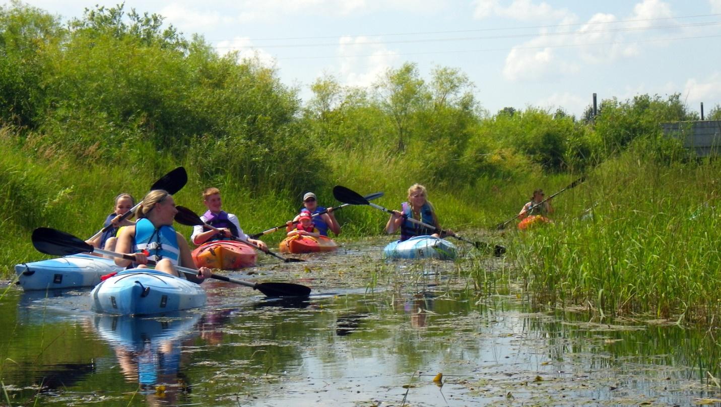 The Warren-Alvarado-Oslo River Watch Team kayaking on the Thief River. Credit: Wayne Goeken/International Water Institute.