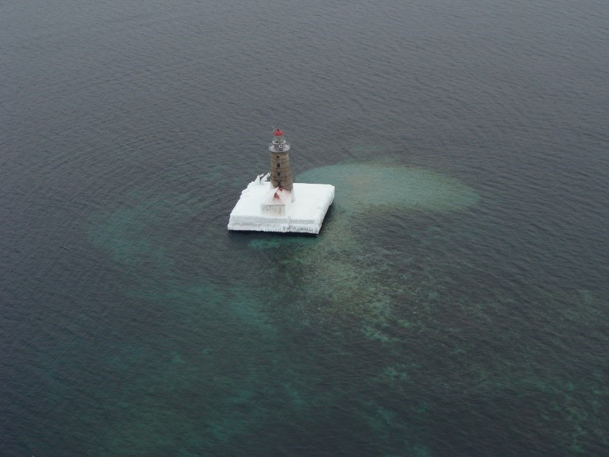 Spectacle Reef Lighthouse in northern Lake Huron surrounded by open water, January 2014. Credit: Dick Moehl