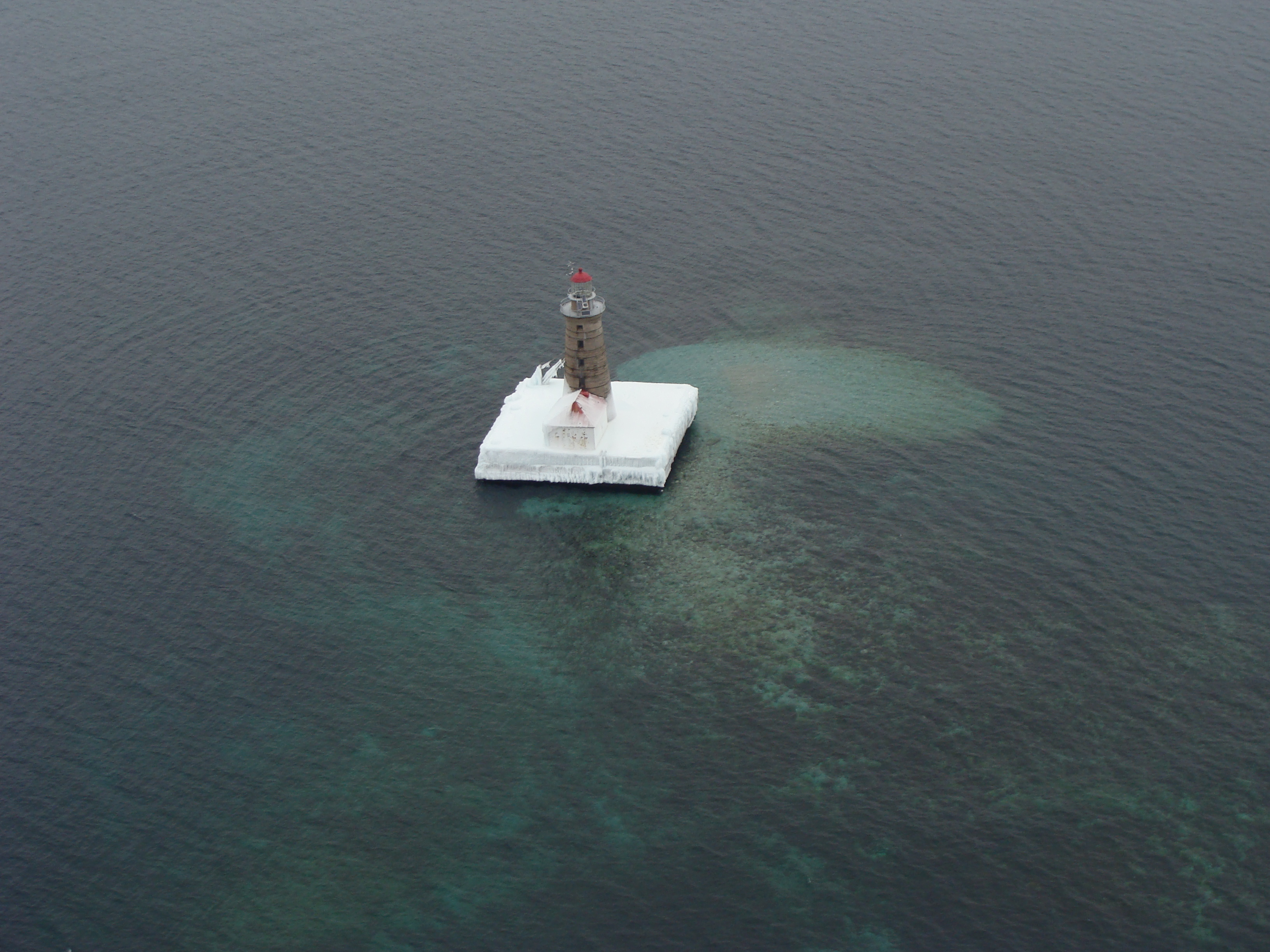 Spectacle Reef Lighthouse in northern Lake Huron surrounded by open water, January 2014. Credit: Dick Moehl.