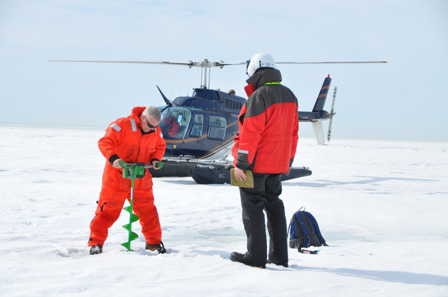 The U.S. Army Corps of Engineers, Buffalo District, and Environment Canada took a helicopter out onto Lake Erie to measure actual ice thickness at six preselected locations in 2015. Credit: Andrew Kornacki