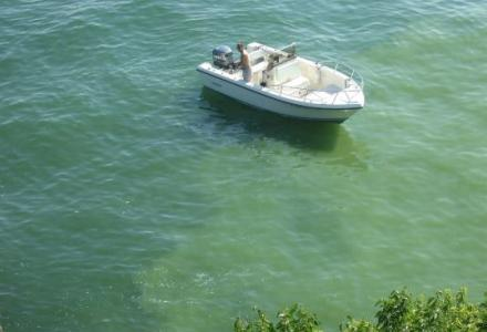 boater floating and fishing in Lake Erie, by harmful algal blooms