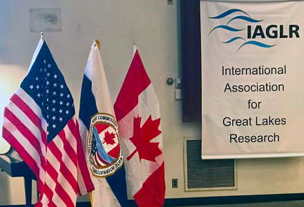 Image of US, Canadian and IJC flag at IAGLR conference in 2019