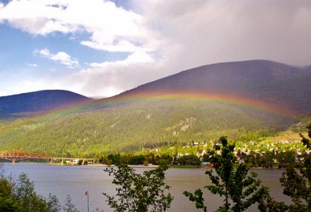 A rainbow over Kootenay Lake and the Nelson Bridge