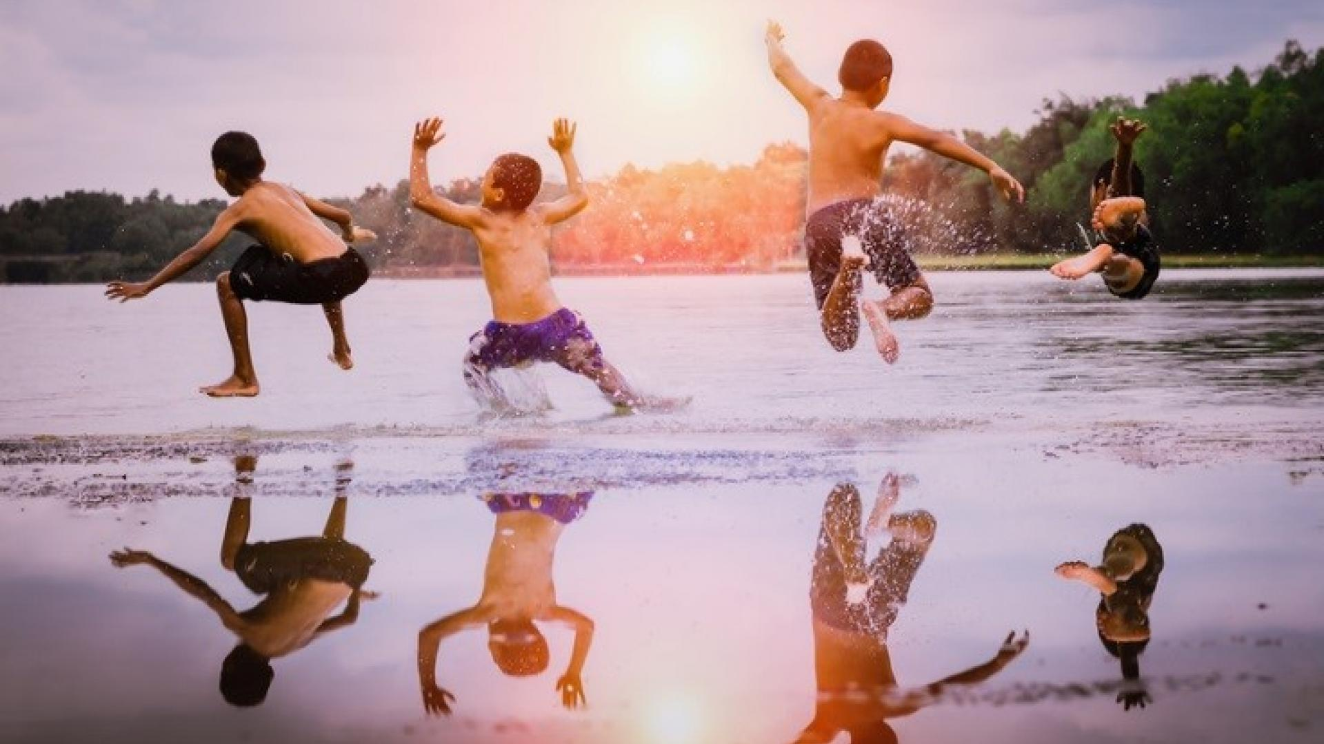 children enjoying water shutterstock